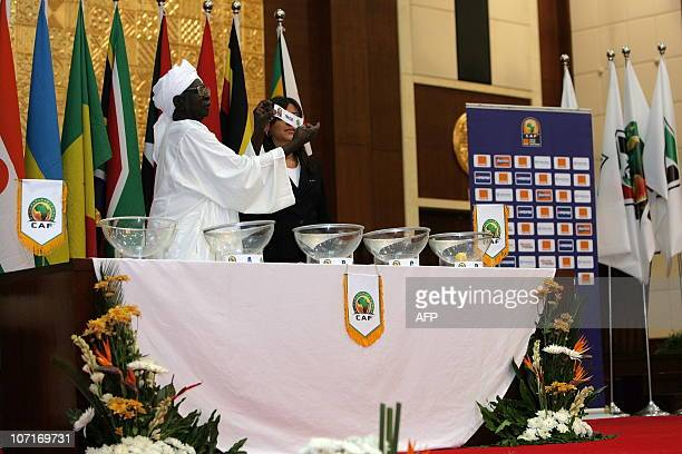 A ticket bearing the name of a country is shown during the draw for the second edition of the competition designed by Confederation of Africa...