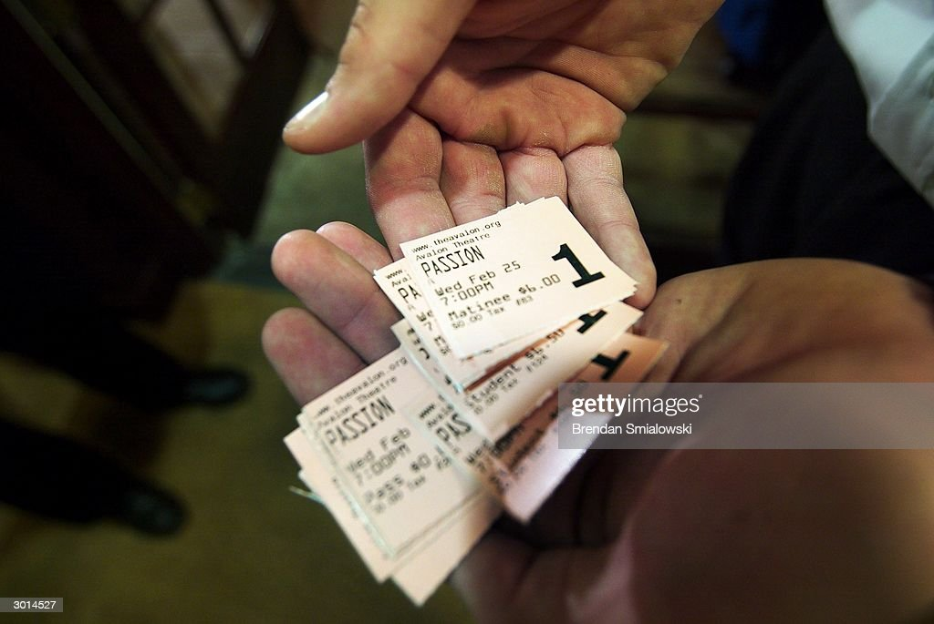 A ticket collector at the Avalon Theater shows a palm full of ticket stubs for the premiere of Mel Gibson's 'The Passion of the Christ' February 25, 2004 in Washington, DC.