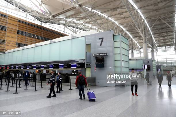 Ticket counters are nearly empty in the international terminal at San Francisco International Airport on March 06 2020 in San Francisco California In...