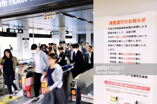 Ticket gates are crowded with commuters rushing through due to powersaving efforts at a subway station on September 10 2018 in Sapporo Hokkaido Japan...