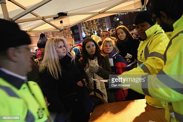 Ticket holders have there tickets scanned to enter Westminster Bridge for New Year firework celebrations on December 31 2014 in London England For...