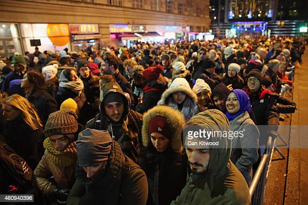 Ticket holders line up as they wait for access to enter Westminster Bridge for New Year firework celebrations on December 31 2014 in London England...