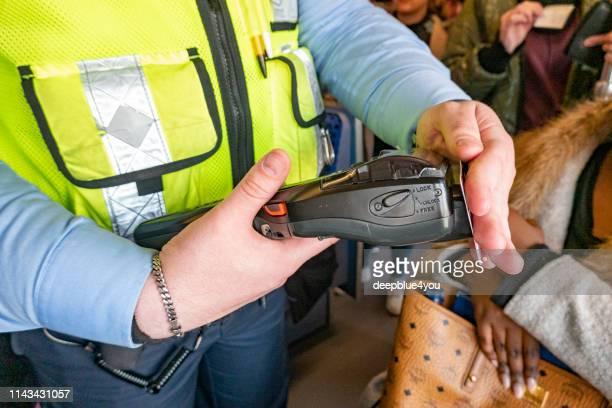 fahrkartenkontrolle während der bahnfahrt, in hamburg - überprüfung stock-fotos und bilder