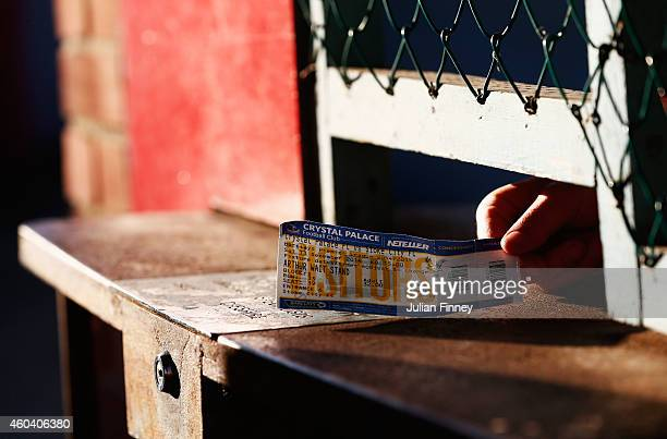 A ticket is checked at the turnstiles prior to the Barclays Premier League match between Crystal Palace and Stoke City at Selhurst Park on December...