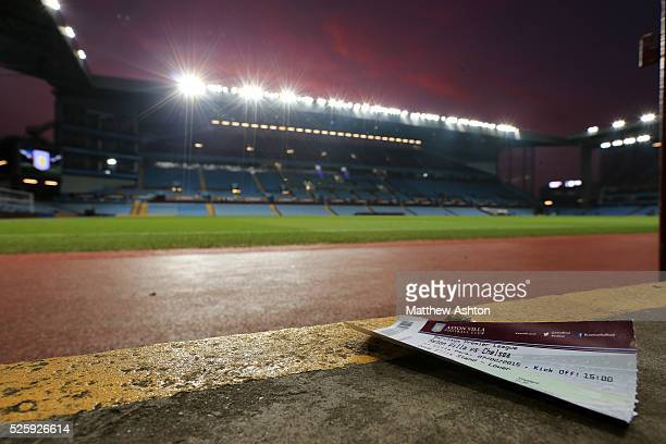 A ticket is left in the Doug Ellis stand against a sunset at Villa Park the home stadium of Aston Villa after the Barclays Premier League fixture...