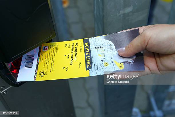 A ticket of Dormtund is used at a cashier prior to the Bundesliga match between Borussia Dortmund and FC Ausgburg at Signal Iduna Park on October 1...