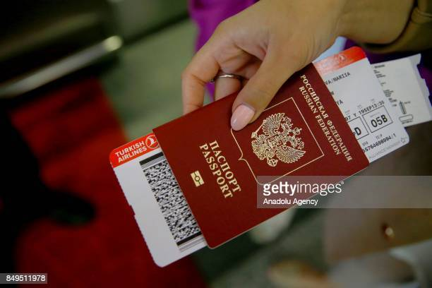 Ticket of Turkish Airlines is seen in a Russian passenger's passport at the Vnukovo International Airport in Moscow Russia on September 19 2017