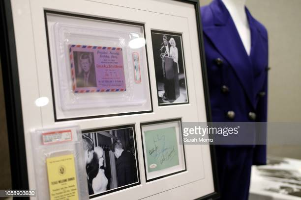 A ticket to President John F Kennedy's birthday celebration is seen along with images of Marilyn Monroe with John F Kennedy and Robert Kennedy at the...