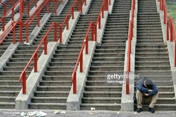 Ticketless fan reacts on the steps outside Wembley Stadium during the 1995 FA cup Final between Everton and Manchester United on May 20, 1995 in...