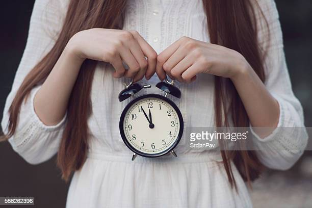 ticking clock - human fertility stock pictures, royalty-free photos & images
