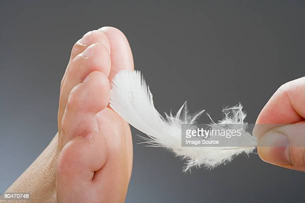 tickling a foot - tickling feet stock photos and pictures