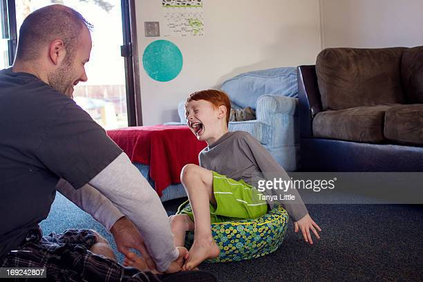ticklish - tickling feet stock photos and pictures