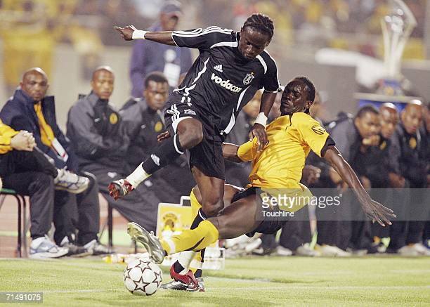 Tico Okonkwo of the Pirates is tackled by David Obua of the Chiefs during the preseason friendly Vodacom Challenge match between Kaizer Chiefs and...