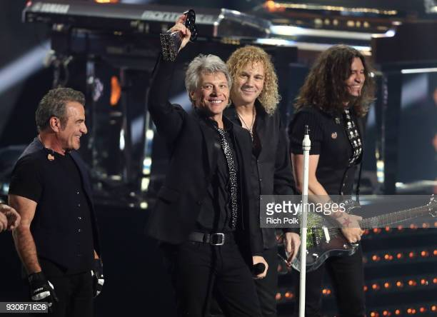 Tico Torres Jon Bon Jovi David Bryan and Phil X of Bon Jovi accept the Icon Award onstage during the 2018 iHeartRadio Music Awards which broadcasted...