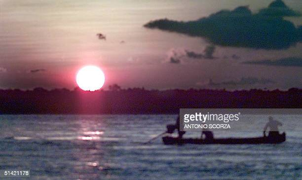 Ticuna tribe Indian crosses Javari River between the cities of Tabatinga in Brazil and the Santa Rosa Island in Peru 27 October 2000 in front of...