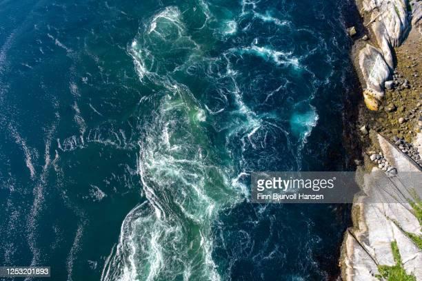 tidal currents at salstraumen seen from salstraumen bridge - finn bjurvoll stock-fotos und bilder