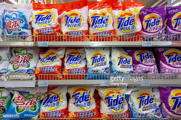 Tide and Arial laundry powder on the shelves in a Chinese supermarket Tide and Arial are both the subbrands of PG PG Profit Falls 31% as Stronger...