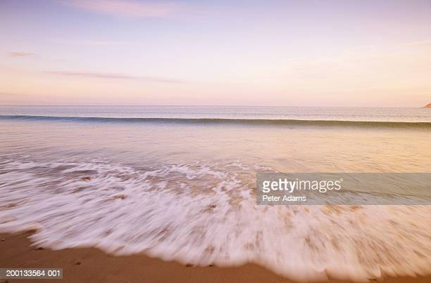tide flow on beach - peter adams stock pictures, royalty-free photos & images