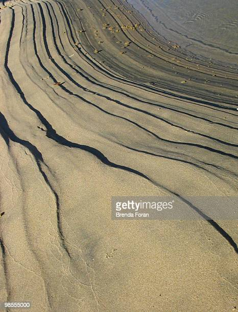 tide lines in sand - coffs harbour stock pictures, royalty-free photos & images