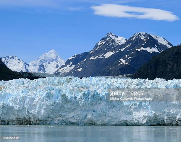 Tidewater glacier, snowy moutains and icebergs