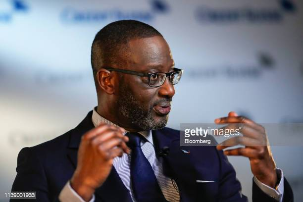 Tidjane Thiam chief executive officer of Credit Suisse Group AG gestures while speaking during a Bloomberg Television interview in Zurich Switzerland...