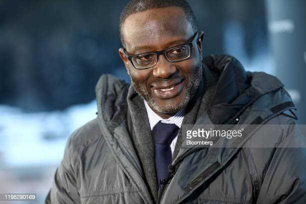 Tidjane Thiam chief executive officer of Credit Suisse Group AG reacts during a Bloomberg Television interview on day two of the World Economic Forum...