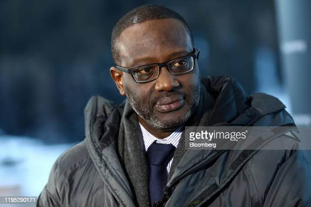 Tidjane Thiam chief executive officer of Credit Suisse Group AG pauses during a Bloomberg Television interview on day two of the World Economic Forum...