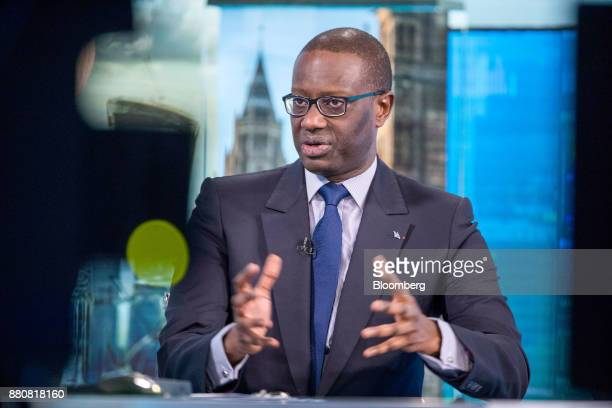 Tidjane Thiam chief executive officer of Credit Suisse Group AG gestures while speaking during a Bloomberg Television interview in London UK on...