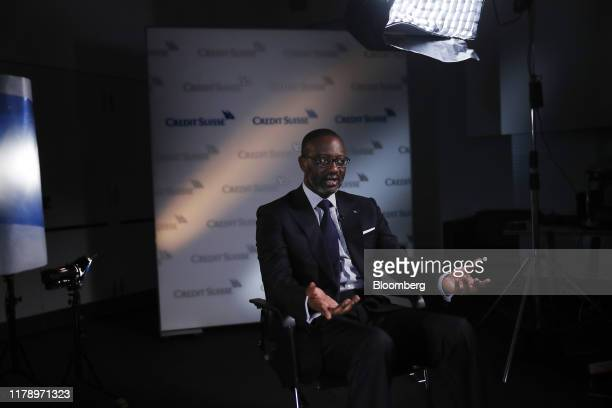 Tidjane Thiam chief executive officer of Credit Suisse Group AG gestures as he speaks during a Bloomberg Television interview in Zurich Switzerland...