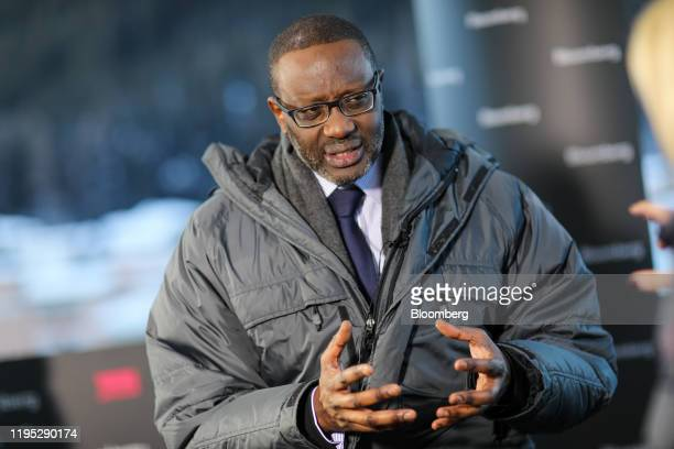 Tidjane Thiam chief executive officer of Credit Suisse Group AG gestures as he speaks during a Bloomberg Television interview on day two of the World...