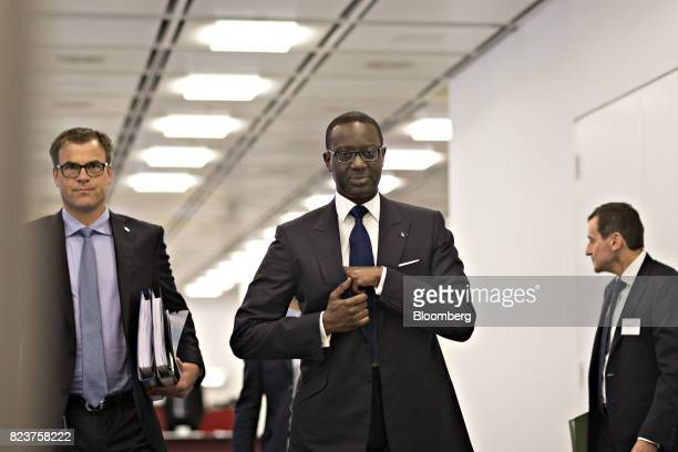 Tidjane Thiam chief executive officer of Credit Suisse Group AG center arrives for a Bloomberg Television interview in Zurich Switzerland on Friday...