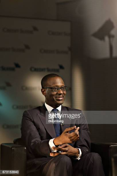 Tidjane Thiam chief executive officer of Credit Suisse Group AG adjusts his cuff links during a Bloomberg Television interview in Zurich Switzerland...