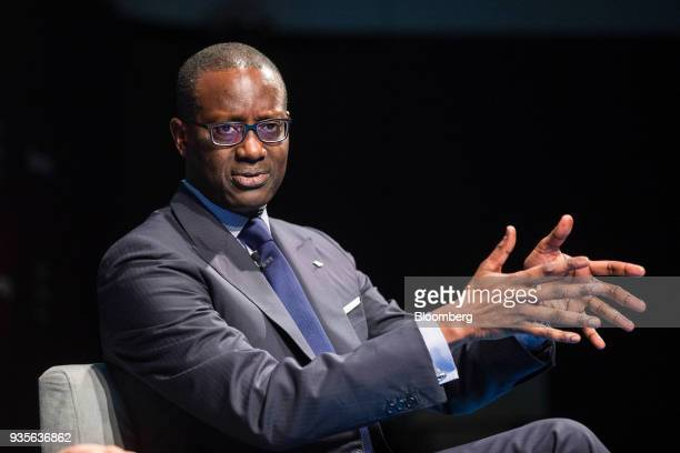 Tidjane Thiam chief executive officer of Credit Suisse Group AG gestures while speaking in an interview during the European Capital Markets at...