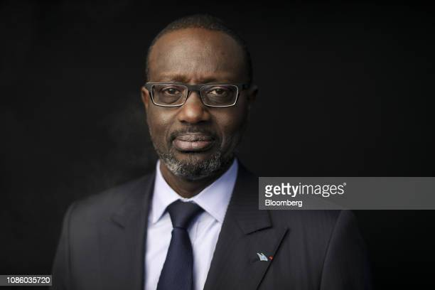 Tidjane Thiam chief executive officer of Credit Suisse Group AG poses for a photograph following a Bloomberg Television interview on the opening day...
