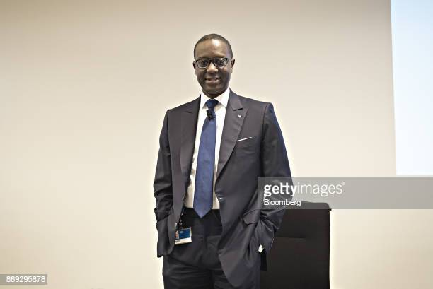 Tidjane Thiam chief executive officer of Credit Suisse Group AG poses for photographs as he arrives for a news conference at the bank's headquarters...