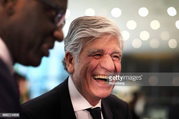 Tidjane Thiam chief executive officer of Prudential Plc left listens as Maurice Levy chief executive officer of Publicis Groupe SA reacts whilst...