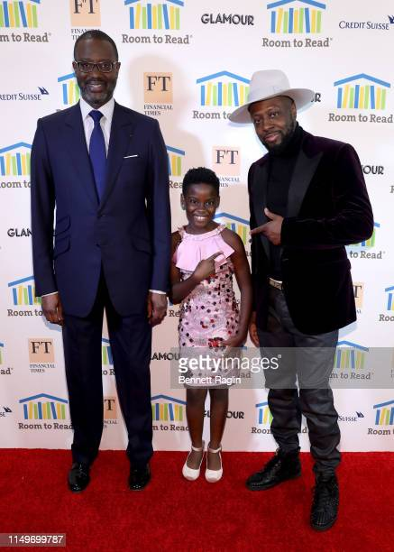 Tidjane Thiam DJ Switch Ghana and Wyclef Jean attend the Room To Read 2019 New York Gala on May 16 2019 in New York City