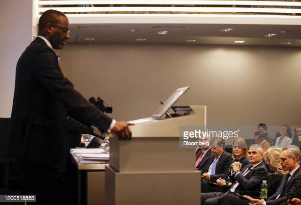 Tidjane Thiam outgoing chief executive officer of Credit Suisse Group AG left speaks as Thomas Gottstein incoming chief executive officer of Credit...