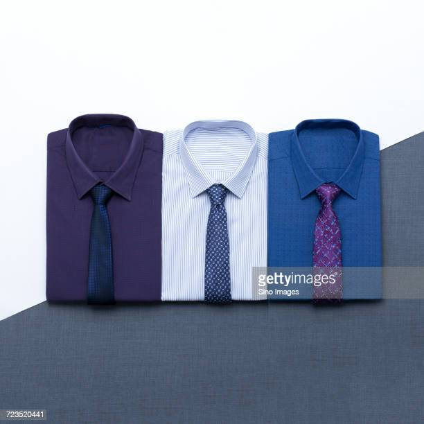 Tidy folded shirts with ties