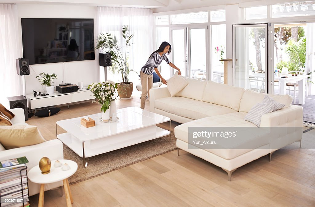 Tidying before her guests arrive : Stock Photo