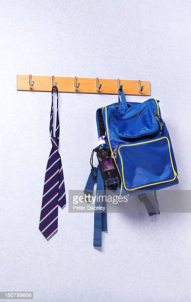 Tie and bag hanging in a school classroom
