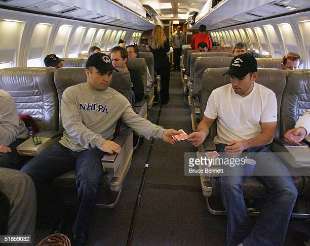 Tie Domi and Alexandre Daigle pass the time on a flight from Prague Czech Republic to Bern Switzerland for the next stop on the Primus Worldstars...
