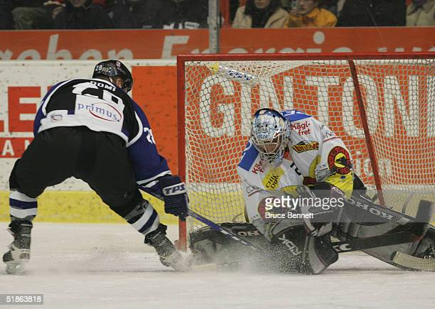 Tie Domi of the Primus Worldstars is stopped by David Aebischer of SC Bern on December 15, 2004 at Bern Arena in Bern Switzerland. The Worldstars won...
