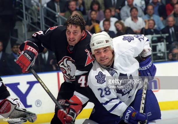 Tie Domi of the Toronto Maple Leafs skates against Richard Smehlik the Buffalo Sabres during the 1999 NHL SemiFinal playoff game action at Air Canada...
