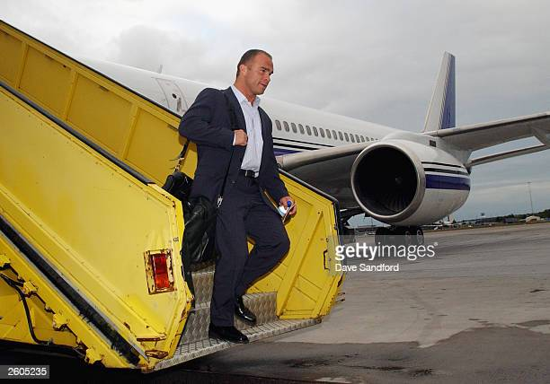 Tie Domi of the Toronto Maple Leafs walks off the plane after arriving for the NHL Challenge 2003 in Stockholm Sweden