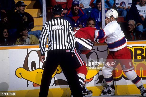 Tie Domi of the Winnipeg Jets fights with Stephane Matteau of the Chicago Blackhawks during a preseason game in September 1993 at the Winnipeg Arena...