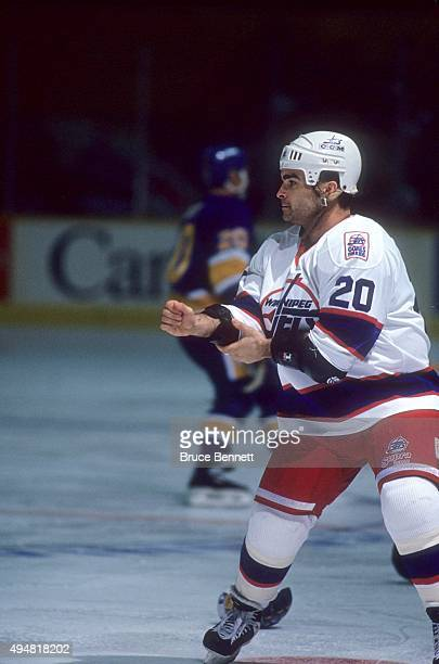 Tie Domi of the Winnipeg Jets gets ready to fight Basil McRae of the St Louis Blues during an NHL game on November 3 1993 at the Winnipeg Arena in...