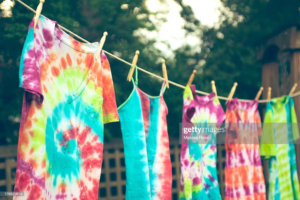 Tie dyed tee shirts hanging from a clothes line. : Stock Photo