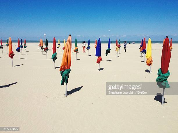 Tied Parasols At Beach Against Sky