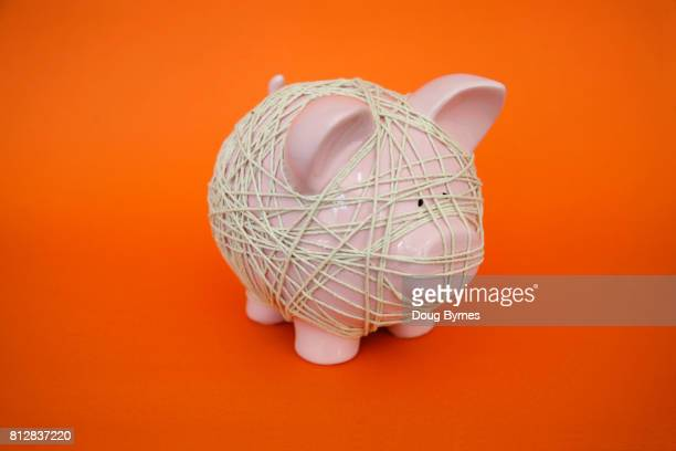 Tied piggy bank